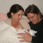 A baby breastfeeding after birth