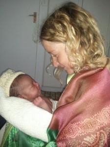 Lisa holding Tadiwa, her son who was born naturally