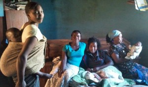 Thokozile, her sisters and Tapsile their mother holding the newborn daughter.